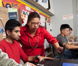 a teacher instructs a student inside her classroom