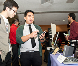 two students look at a screen together in a conference