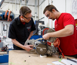 a teacher and student build something in a workshop