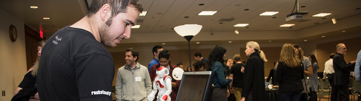 a student looks at a computer at an event