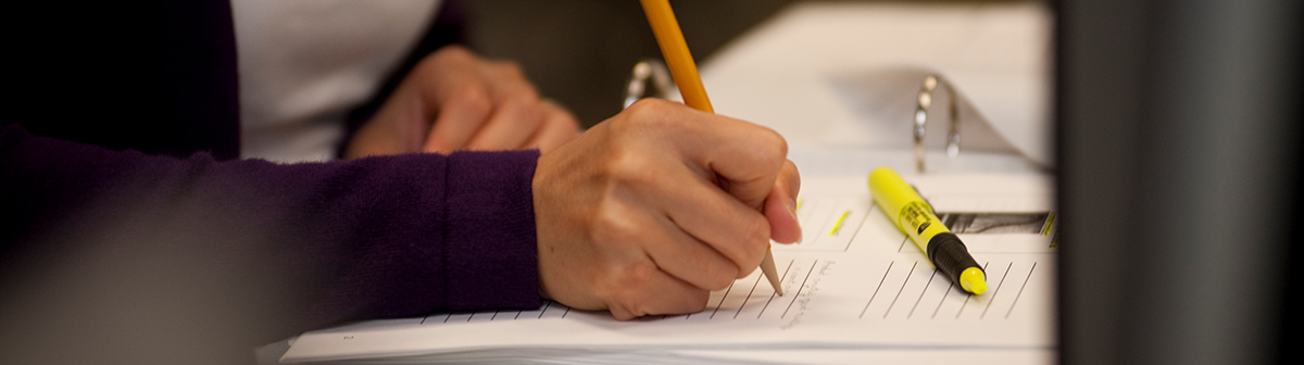 a student writes a paper in class