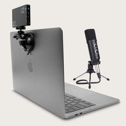 open laptop with a light and microphone