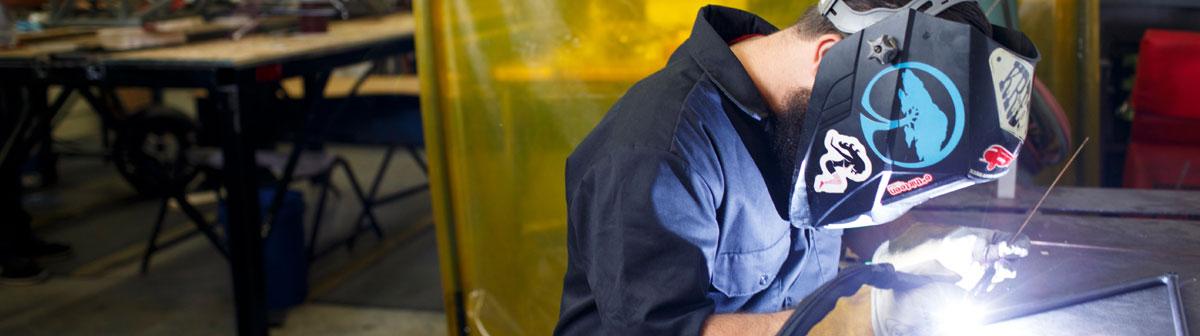 Engineering student welding.