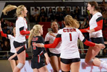 CSUN's volleyball team celebrating a vistory in a game