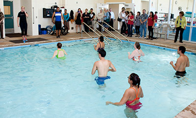 People in pool doing an activity.