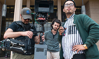 Students in front of Oviatt Library with a Camera rig.