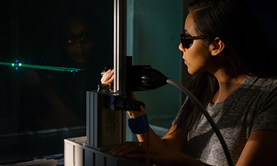Students using a laser equipment.