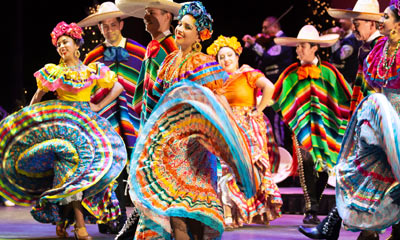 Colorful Flamenco dancers on stage.