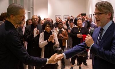 The Soraya Director shaking hands with an artist.