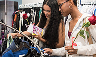 Students looking through clothes